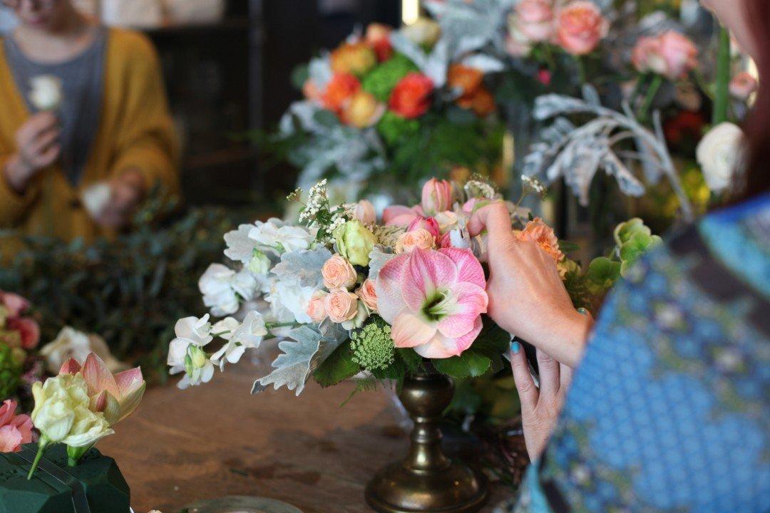 Florist Arranging Bouquets In A Flower Shop